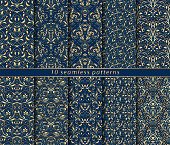 Collection of seamless gold patterns on blue background. Rich ornamentation in the Baroque style. Ten vector illustrations for textile design, packaging, printing or paper.