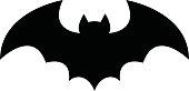 A vector illustration of a flying bat