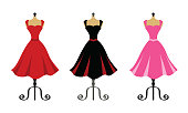 Red, black and pink dress on mannequin stands
