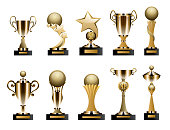 Beautiful golden trophy cups and awards of different shape realistic set isolated on white background. Vector illustration.