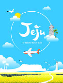Beautiful Korean Island, Jeju. Blue sky and plane, yellow rapeseed field background. Jeju Island Spring Trip.