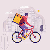 Pizza bicycle delivery man with parcel box on the back. Ecological city bike food delivering service concept with courier carrying package on modern city background. Food delivery cyclist.