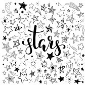 big set of hand drawn doodle stars black and white isolated on background. Hand drawn calligraphy stars lettering