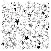 big set of hand drawn doodle stars black and white isolated on background.