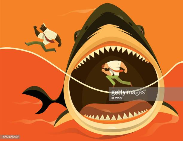 big shark attacking businessmen