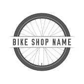 Bikes Shop Emblem. Design Element for Bike Shop or Advertising Banner. Bicycle Wheel Silhouette and Place for Your Bike Shop Name, Monochrome Vector Illustration.