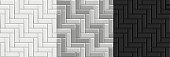 Black and white seamless textures of herringbone tiles. Set of vector grayscale paving floor