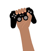 Black arm holding in high a black video games controller isolated on white. Gamer concept of victory. Gamepad with red light, buttons and joysticks.