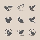Bird icons set. Dove and pigeon abstract symbol. Can be used for freedom or peace, spa, beauty, health or family care center design concept