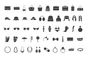Black icons accessories: bags, hats jewelry glasses Vector