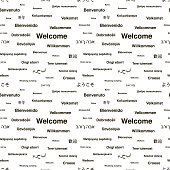 Black welcome phrases in different languages of the world on white, seamless pattern