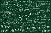 Chalkboard inscribed with scientific formulas and calculations in physics and mathematics.