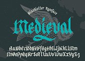 Gothic medieval typeface. Black-letter fracture font with flying fish illustration.