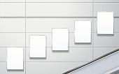 blank billboards on the wall in modern public space