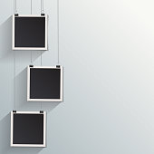 Blank retro vintage photo frame set hanging on a clip. Realistic detailed photo icon design template. Vector isolated on white wall background.