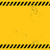 blank warning banner with two textured black stripes on yellow background, the grunge effect is pale therefore it is perfect for banner contents