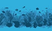 Hand drawn underwater natural elements. Coral reef horizontal seamless pattern.  Blue monochrome silhouettes of corals, clam and swimming tropical fishes. Undersea bottom texture.