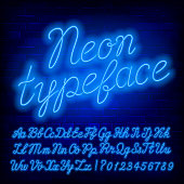 Blue Neon alphabet font. Blue neon color lowercase and uppercase script letters and numbers. Stock vector typeface for your typography design.