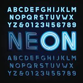 Blue neon tube alphabet font. Light turn on and off. Type letters and numbers on a dark background. Vector typography for labels, titles, posters etc.