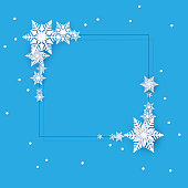 Blue square winter template with white beautiful snowflakes. Christmas and New Year decoration. Vector background.