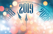 Blurred shiny New Year 2019 poster with clock. Festive decoration. Vector background.