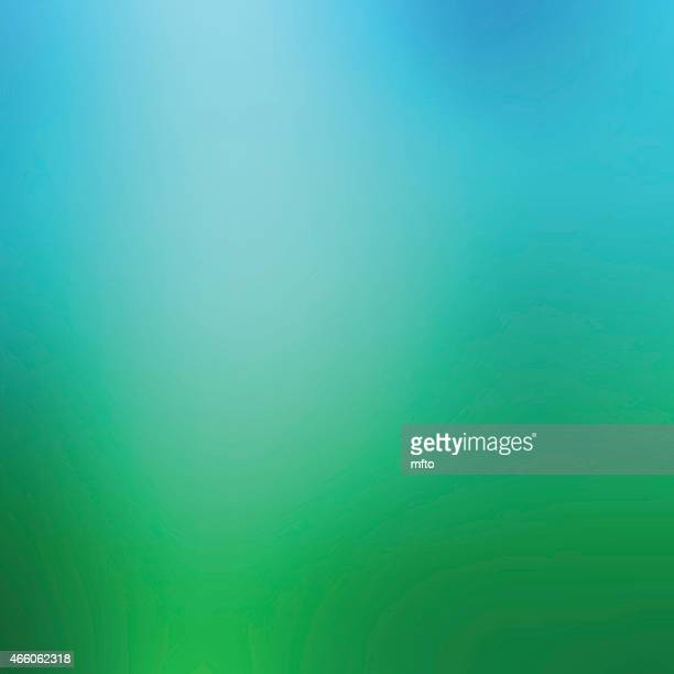 Bokeh background in shades of emerald and green