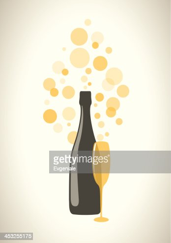bottle and glass of champagne with bubbles on grey