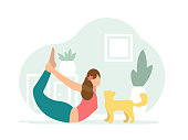 Woman in red t-shirt and blue pants practices yoga at home with a cat in a bow pose dhanurasana. Flat style character vector illustration on green background.