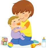 little boy hugging a baby