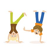 Boy and girl standing upside down on their hands. Children having fun or athletics. Morning exercise or playing sports. Flat character isolated on white background. Vector, illustration EPS10