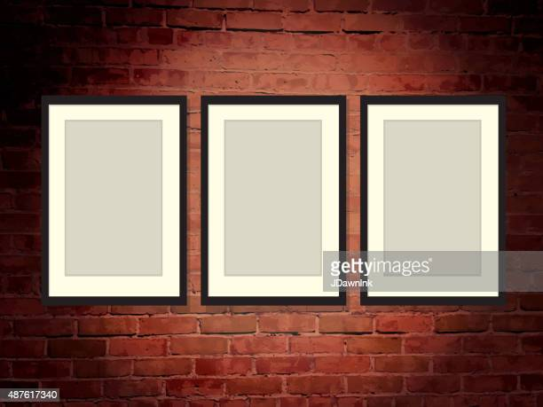 Brick wall art gallery background with frames