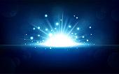 Vector Illustration Of Bright blue light rising from the black horizon