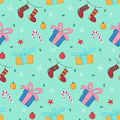 Bright Christmas seamless pattern with cute hand drawn gift boxes and stockings. Winter texture with holiday balls, candies, snowflakes for textile, wrapping paper, wallpaper, new year decor