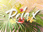 Bright exotic summer design with lettering integrated to tropical plants and flowers. Vector background of hibiscus flowers and palm tree leaves.