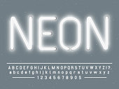Bright glowing white neon sign characters. Vector font with simple glow realistic light effects alphabet text letters and numbers lamps template on gray background
