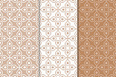 Brown and white geometric ornaments. Set of seamless patterns for web, textile and wallpapers