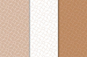 Brown and white geometric seamless patterns for web, textile and wallpapers