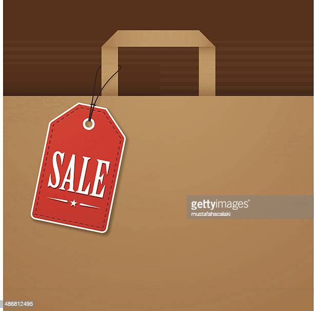 Brown paper bag with red sale tag