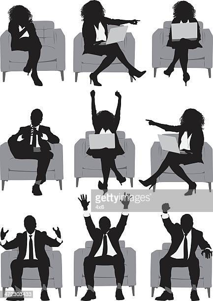 Business executives sitting on armchairs