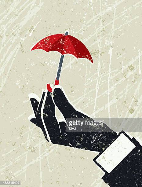 Business Man's Hand Holding a Tiny Umbrella