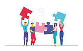 Business team doing a puzzle - flat design style colorful illustration on white background. Metaphorical composition with cute characters, office workers or businessmen putting pieces together