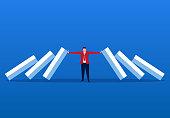 Businessman blocking domino effect