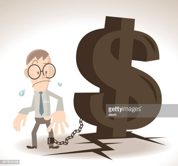 Businessman (man) chained (locked, tied up) with a huge dollar sign iron chain on cracked ground