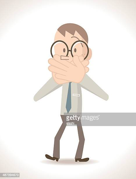 Businessman covering his mouth with hands (speak no evil gesture)