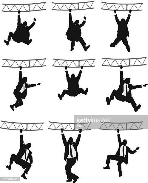 Businessman hanging on a metal structure