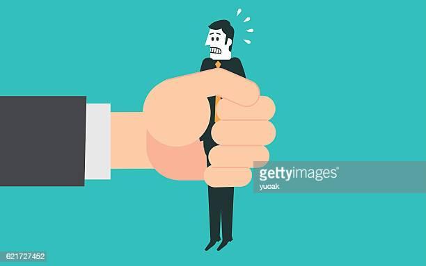 Businessman in a big hand