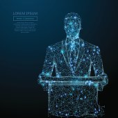 Abstract image of a business man standing behind rostrum in the form of a starry sky or space, consisting of points, and shapes in the form of planets, stars and universe. Vector wireframe concept.