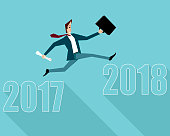 Businessman jumping between 2017 and 2018