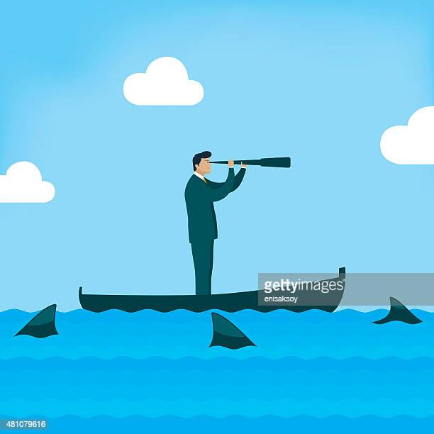 Businessman looking on boat with sharks around him