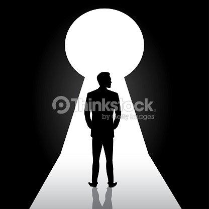 businessman silhouette standing front of door keyholeman in sui